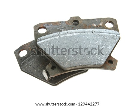 Used brake pads isolated on white backgroun - stock photo
