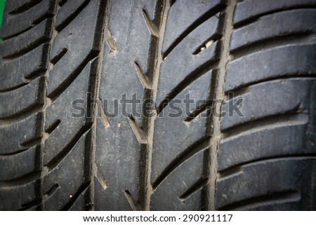 used car tire isolated on black background. - stock photo