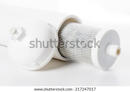 used cartridge for water filtration, activated carbon block filter - stock photo