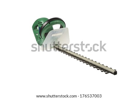 Used electrical hedge clippers with black blades and green engine case isolated on white background - stock photo