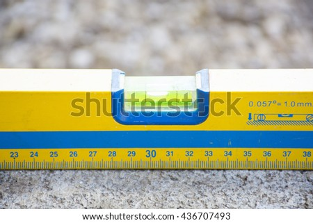 Used level tool on brick with background rock nature.Background construction tool or craftsman tool background.Close up - stock photo