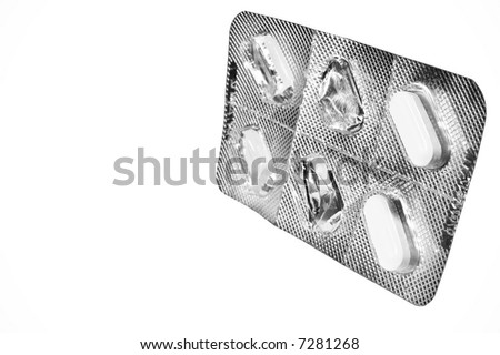 Used medicine tablet blister-pack isolated against a white background. - stock photo