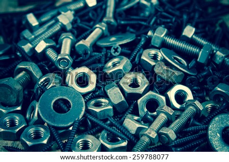 used nut and bolts for equipment industrial background - stock photo