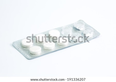 used one packs of pills on white background - stock photo