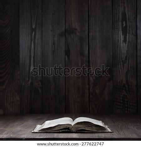 used open book on wooden table - stock photo