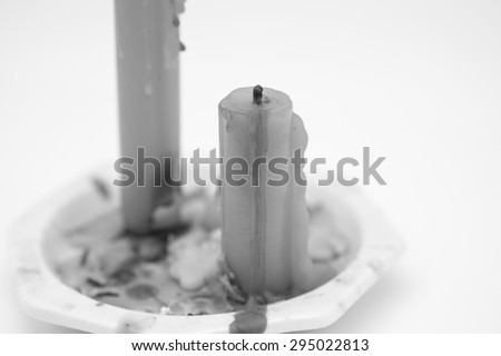 Used or burnt candle stick in black and white for religion symbol background - stock photo