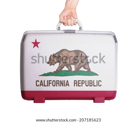 Used plastic suitcase with stains and scratches, printed with flag, Calofornia - stock photo