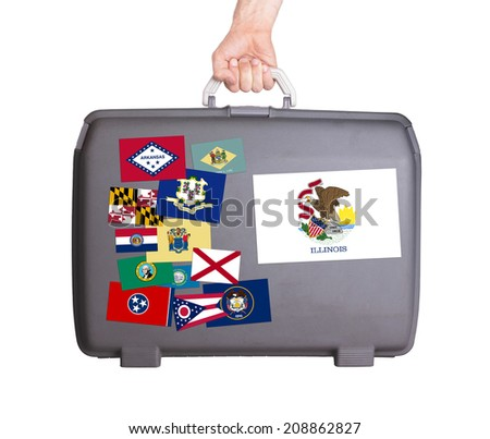 Used plastic suitcase with stains and scratches, stickers of US States, Illinois - stock photo