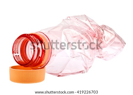 Used red plastic bottle on a white background - stock photo