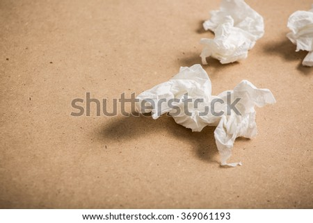 used screwed paper tissue on table - stock photo