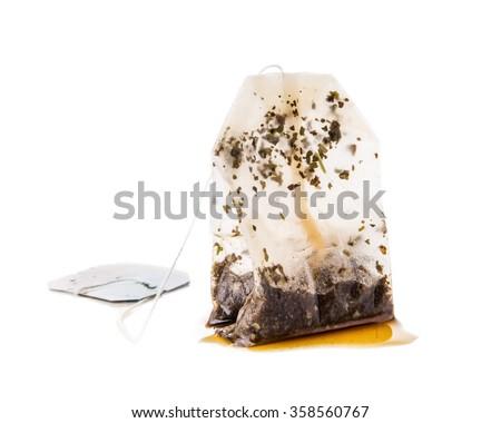 Used Tea Bag on White Background - stock photo