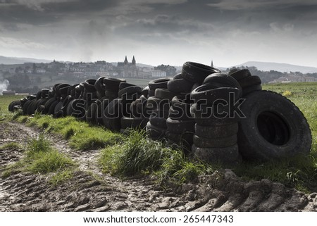 used tires stacked on the nature - stock photo