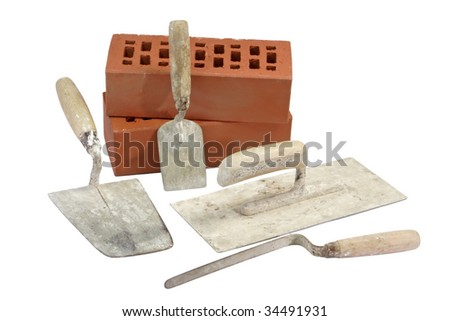 Used trowels with red bricks - isolated on white background - stock photo