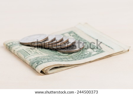 used US banknotes on wood table close up - stock photo