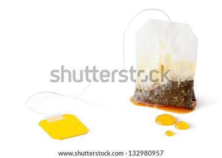 Used wet teabag. Isolated on a white. - stock photo