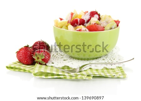 Useful fruit salad of fresh fruits and berries in bowl isolated on white - stock photo
