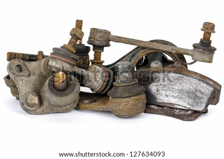 Useless, worn out and rusty suspension car parts - stock photo