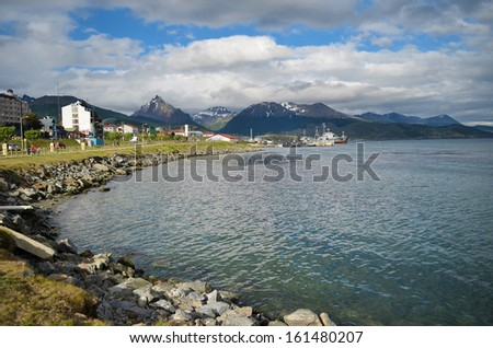 Ushuaia bay in Argentina and the cloudy sky - stock photo