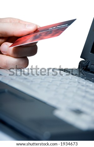 using a credit card on the net - stock photo