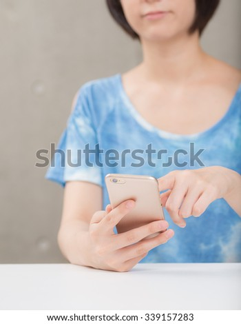 Using a smart phone. - stock photo