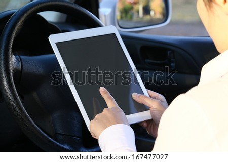 Using a tablet pc in a car - stock photo