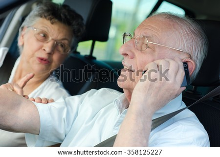 using cellphone while driving - stock photo