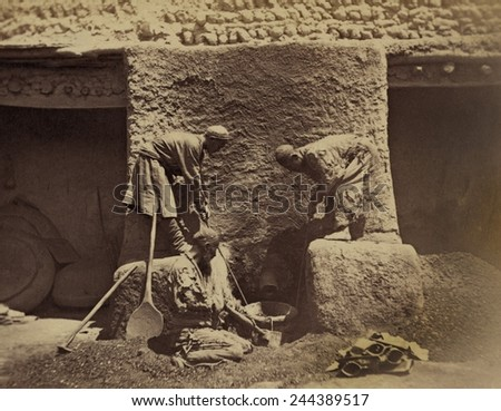 Using centuries old methods, men smelting iron ore in a primitive forge to make cast-iron in Turkestan, Central Asia. Between 1865-1872. - stock photo