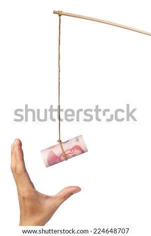 Using Chinese yuan as a bait depicting greed, isolated on white background  - stock photo