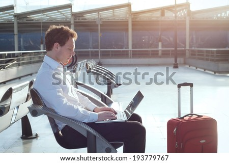 using internet in the airport terminal - stock photo