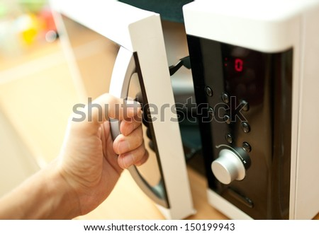 Using microwave oven - stock photo