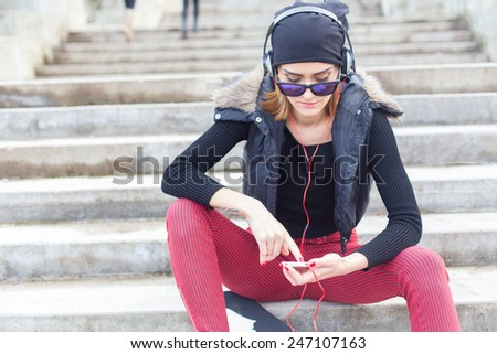 Using mobile phone for music listening. - stock photo