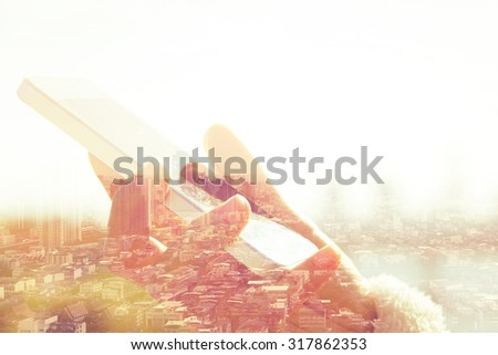 Using smart phone double exposure. Business technology concept. - stock photo
