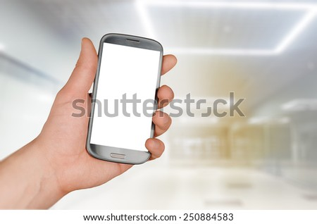 Using smartphone in a market, mall or department store - stock photo
