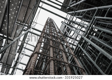 Using steel wire for securing steel bars with wire rod for reinforcement of concrete or cement. focus to steel wire - stock photo