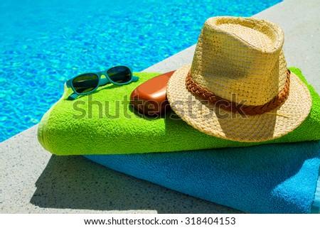 Using sunblock when having a sunbath - stock photo