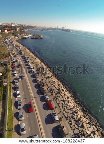 Uskudar Sahil Yolu. Aerial view of Harem Street in Istanbul. Showing many cars and coastal street along Bosphorus Sea. - stock photo