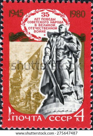 USSR - 1980: A stamp printed in the USSR shows monument to man, holding a child's on one hand and a sword in other hand. Title: 35th anniversary of the Soviet victory in the Great Patriotic War. 1945 - stock photo