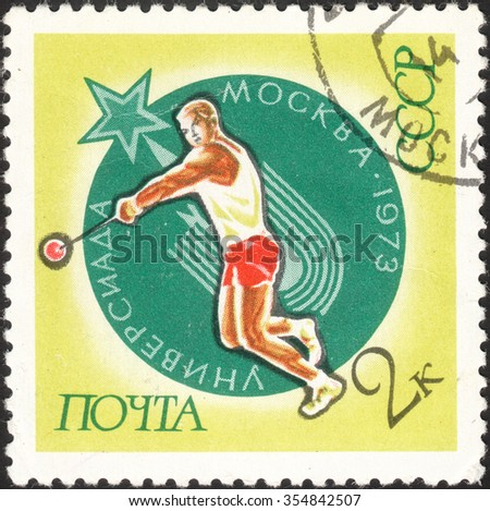 USSR - CIRCA 1973: A post stamp printed in the USSR shows a sportsman with a shot and devoted to The Universiade' 1973 in Moscow, circa 1973 - stock photo