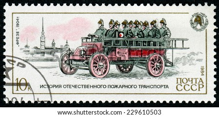 USSR-CIRCA 1984: A post stamp printed in USSR show firemen Frese 1904, devoted history of fire transport, circa 1984. - stock photo