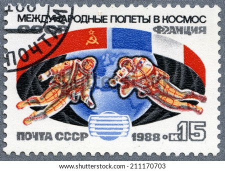 USSR - CIRCA 1987: A post stamp printed in USSR- The international space flights - USSR and France, circa 1987  - stock photo