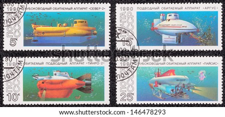USSR - CIRCA 1990: A set of postage stamps printed in the USSR, shows Russian submarine, circa 1990 - stock photo