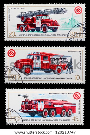 USSR - CIRCA 1985: A set of postage stamps printed in USSR shows historic fire truck, series, circa 1985 - stock photo