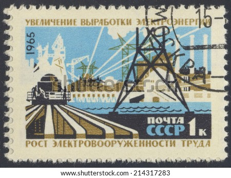 USSR - CIRCA 1965: A stamp printed in the USSR, shows construction, circa 1965 - stock photo