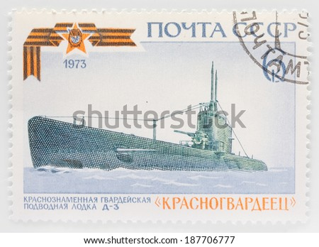 USSR - CIRCA 1973: A stamp printed in The USSR shows image of a russian submarine, series, circa 1973  - stock photo