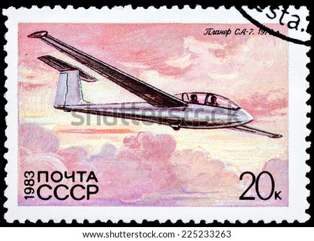 "USSR - CIRCA 1983: A Stamp printed in USSR (Russia) shows the Glider with the inscription ""SA-7, 1970"", from the series ""History of the Soviet Gliding"", circa 1983  - stock photo"