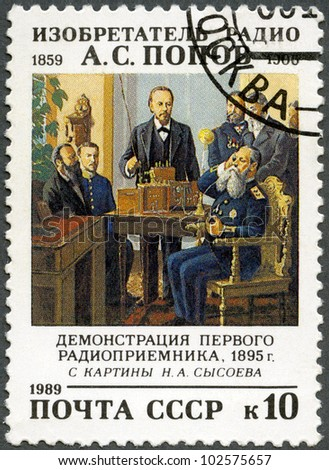 USSR - CIRCA 1989: A Stamp printed in USSR shows Aleksandr Popov (1859-1905), Inventor of Radio in Russia, Demonstration of the First Radio Receiver, 1895, by N. Sysoev, circa 1989 - stock photo