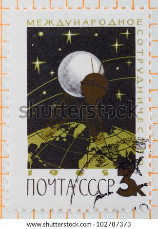 USSR - CIRCA 1965: A stamp printed in USSR shows flight of communication satellite, circa 1965 - stock photo