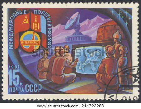 USSR - CIRCA 1981: A stamp printed in USSR shows Intercosmos program - the people of Mongolia are watching on television flight Space Station, circa 1981 - stock photo