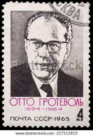 USSR - CIRCA 1965: A stamp printed in USSR shows portrait of Otto Grotewohl - German politician, circa 1965 - stock photo