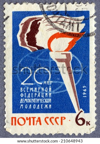 USSR - CIRCA 1965: A stamp printed in USSR  - 20 years of World Federation of Democratic Youth, circa 1965  - stock photo
